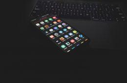 black iphone 5 on black computer keyboard