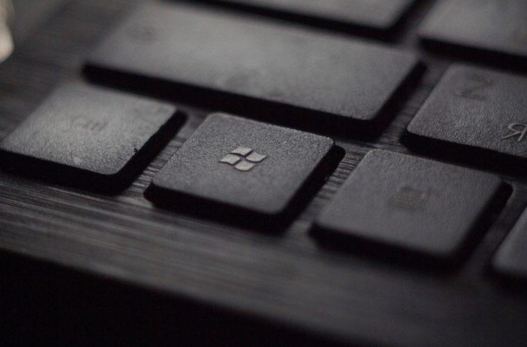 black laptop computer keyboard in closeup photo